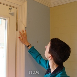 wife in kitchen with new moldings