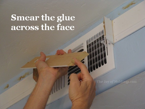 Glue in place last piece of crown molding air vent box