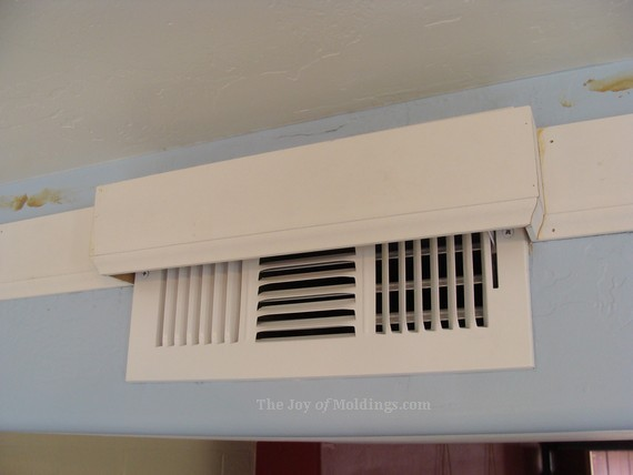 crown molding box around air vent in kitchen