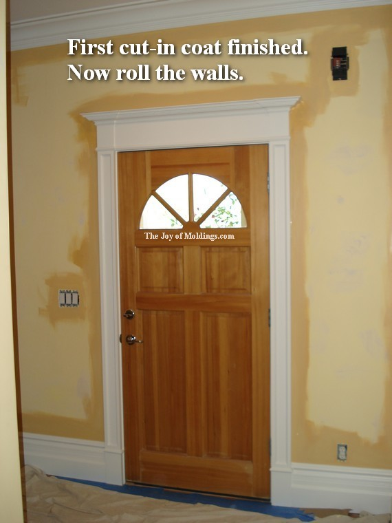 Walls Painted Around Front Door With Lots Of Moldings