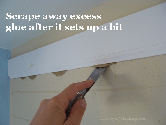 lower detail glued to brick wall for crown molding