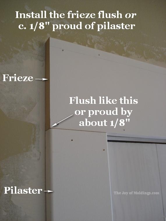 door trim header on top of pilaster moldings