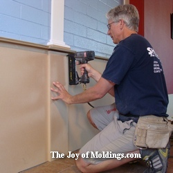 finish carpenter installing wainscoting