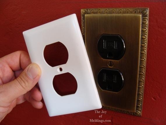 egg and dart brass wall plug cover