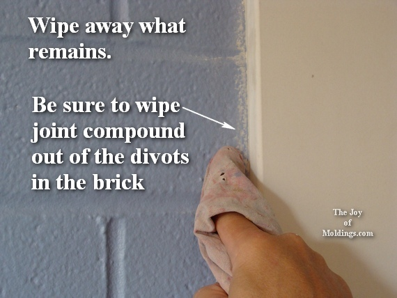 moldings on a kitchen brick firewall between townhouse units