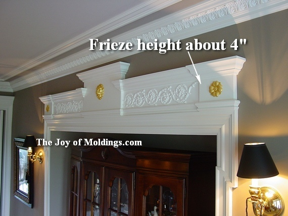 dining room moldings with frieze on archway