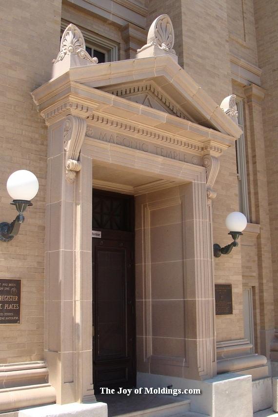 historic door surround with corbels and pediment