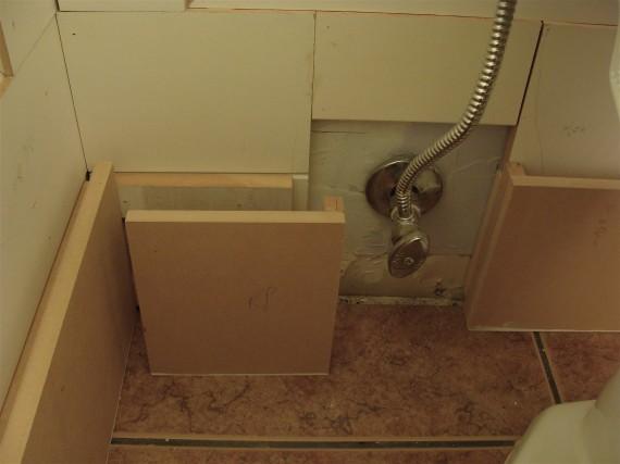 baseboard molding behind toilet