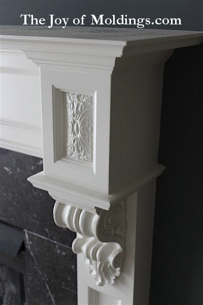 ornate fireplace mantel capital